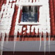 Icicles on building roof at winter day — Stock Photo #2523489