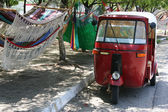 Motorcycle rickshaw and hammocks — Stock Photo