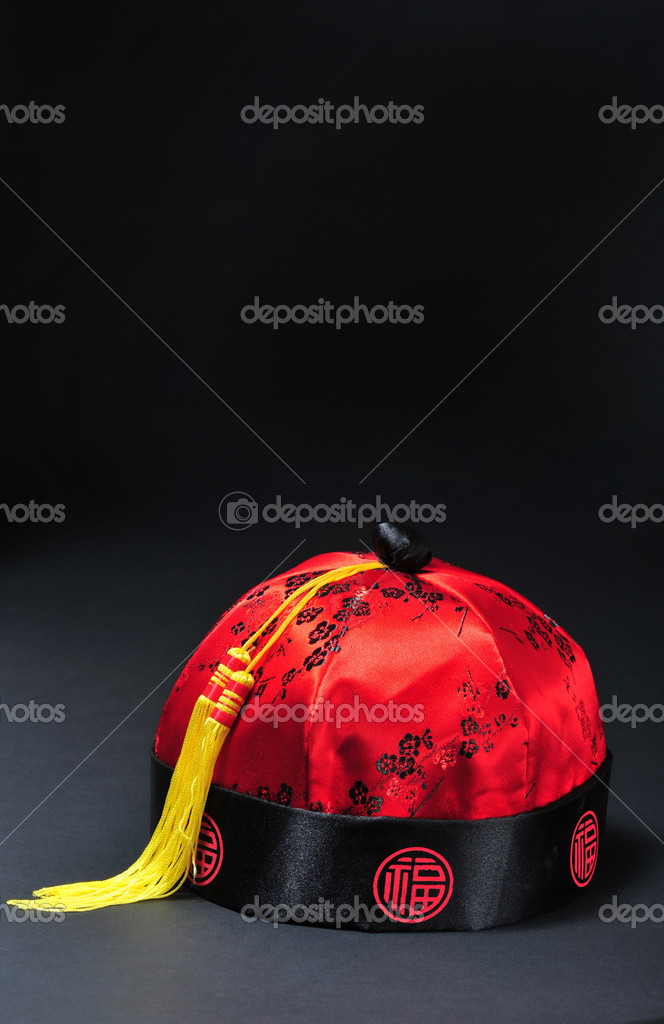 Red Chinese New Years hat will bring good luck. — Stock Photo #1666454
