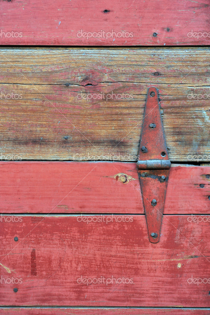 A portion of a old red worn barn door. — Stock Photo #1666569