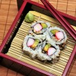Stock Photo: Sushi Californirolls in box.