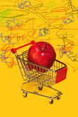 Apple in a shopping cart. — Stock Photo