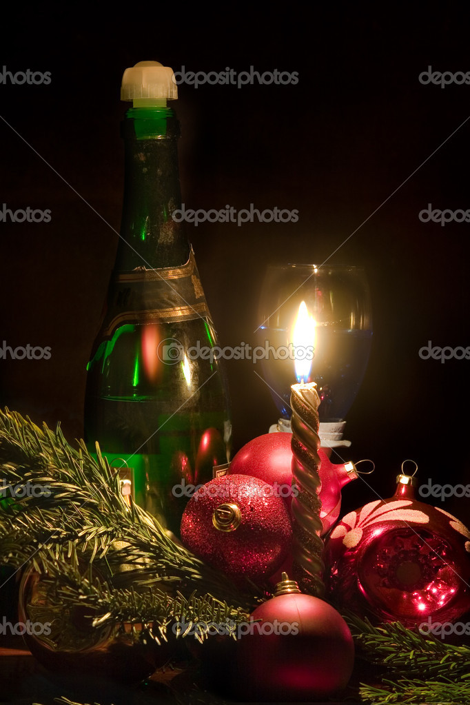 Candle and christmas-tree decorations on a black background — Stock Photo #1624955