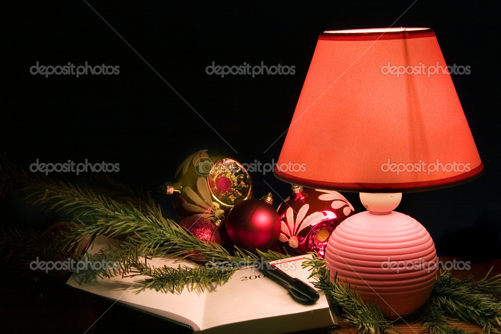 Desk lamp, christmas-tree decorations and notebook  — Stock Photo #1625770