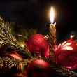 Candle and christmas-tree decorations — Stok fotoğraf