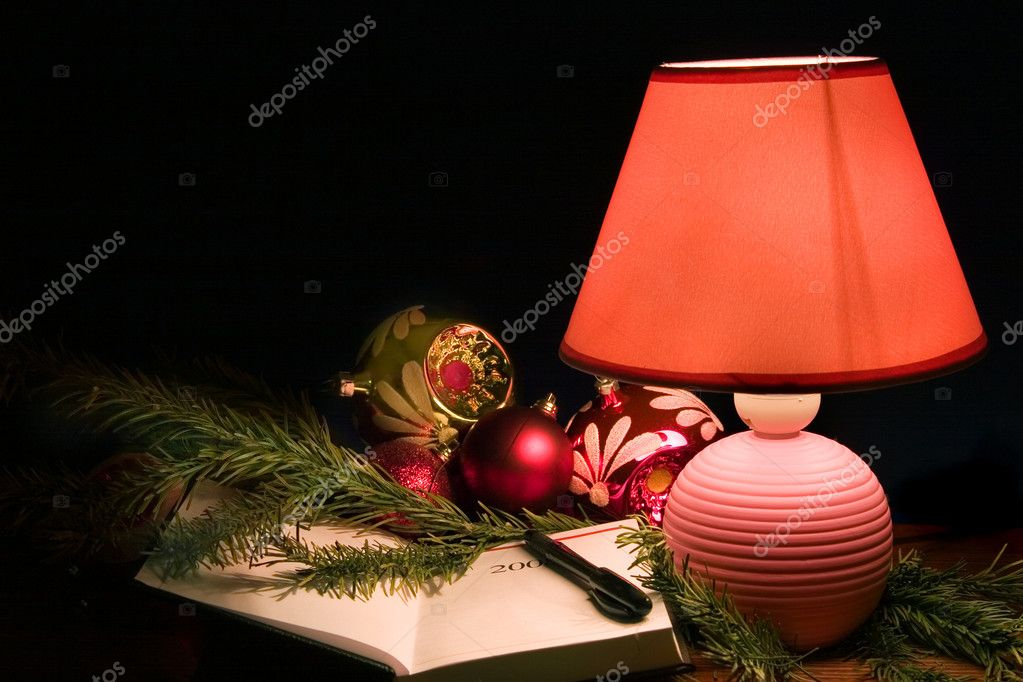 Desk lamp, christmas-tree decorations and notebook   Stock Photo #1720573