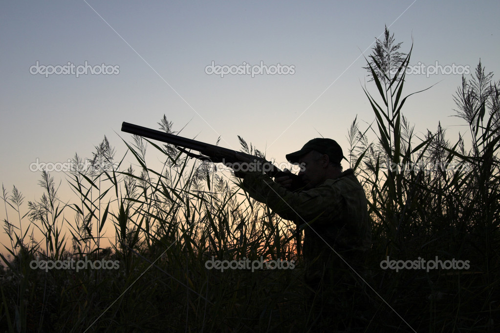 Silhouette of the hunter on a background of a morning dawn — Stock Photo #2129411
