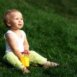 Little boy on a grass — Stockfoto