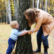 Stock Photo: Mother with son play seek and hide