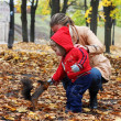Little boy feeds a squirrel - Stock Photo