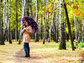 Women with umbrella in a park — Stock Photo