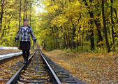 Young women walking on rails — Stock Photo