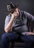 Tired man sitting on a chair — Stock Photo