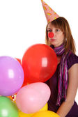 Sad girl with colored baloons — Stock Photo