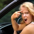 Girl screams to another driver - Stock Photo