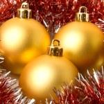 Christmas yellow balls and fur-tree tins — Stock Photo
