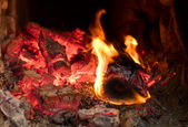 Fire brightly burning in the furnace — Stock Photo