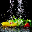 Tulips in pouring water — Stock Photo