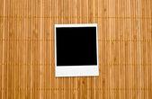 Blank photo frame on bamboo — Stock Photo