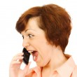 The screaming girl with mobile phone iso — Stock Photo #1611560