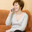 Smiling girl talking by mobile phone — Stock Photo
