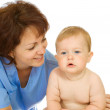 Doctor and small smiling baby — Stock Photo