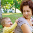 Baby with mother in wood — Stock Photo