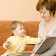 Small girl and mother with laptop — Stock Photo