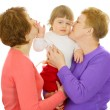 Small baby with mother and grandmother i - Stock Photo