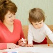 Painting small girl with mother — Stock Photo