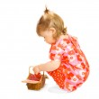 Small baby in red dress with toy basket — Stock Photo #1613790