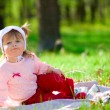 Small smiling little girl at summer fore — Stock Photo #1613867