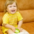 Little smiling girl in yellow eat apple — Stock Photo #1614038