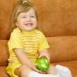 Smiling girl in yellow with green apple — Stock Photo #1614062