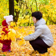 Stock Photo: Girl with her mother on autumn forest