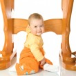 Stock Photo: Small baby sitting with table #7 isolate