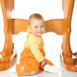 Foto de Stock  : Small baby sitting with table #7 isolate