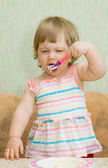 Little funny eating girl — Stock Photo