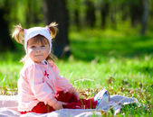 Small smiling little girl at summer fore — Stock Photo