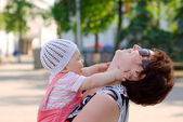 Woman playing with small baby — Stock Photo