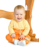 Small baby sitting with table — Stock Photo