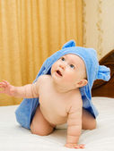 Small baby in blue towel on bed #6 — Stock Photo
