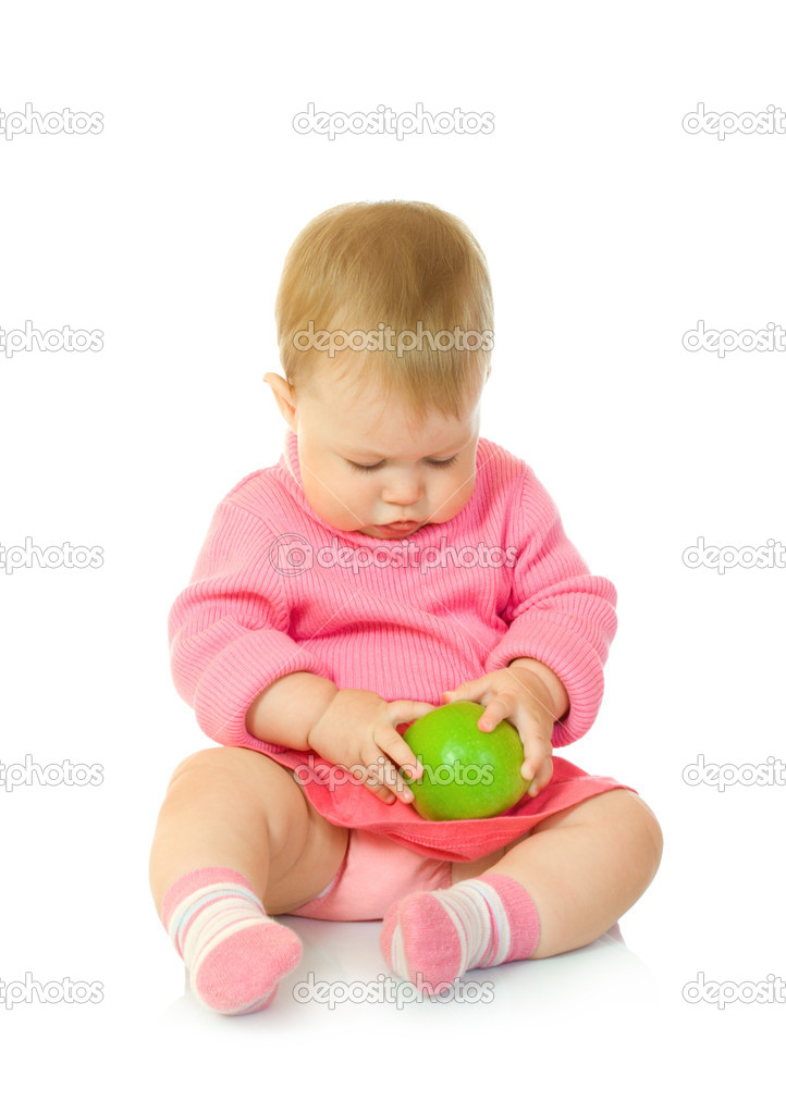 Small baby in red with green apple — Stock Photo #1612296