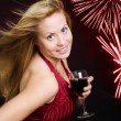 Smiling woman holding wine and celebrati — Stock Photo #1593497