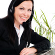 Smiling brunette woman with headphone — Stock Photo