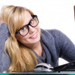 Closeup of smiling blond woman in glasse — Stock Photo