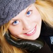Smiling blond woman in winter clothes po — Stock Photo #1597860