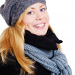 Smiling blond woman in winter clothes po — Stok fotoğraf