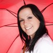Smiling woman with umbrella — Stock Photo