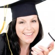 Smiling brunet student girl in cap with — Stock Photo